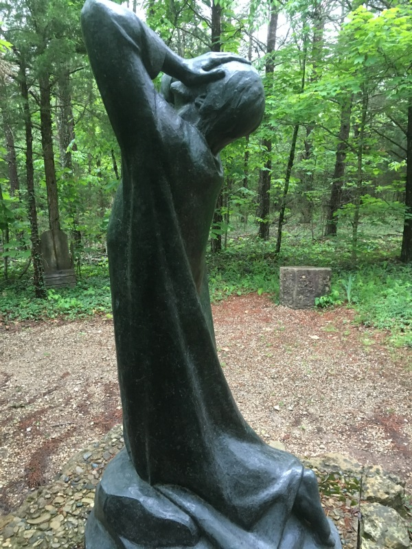"This is a sculpture located on a prayer path at Gethsemani Abbey in Kentucky. It shows Jesus in the garden crying out to God. One of the phrases recorded that Jesus prayed was, ""Not they will; but yours."""